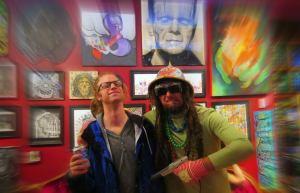 Montreal Street Artist Chris Dyer pulls a gun on fellow artist Daniel Libman at Greenlight Gallery.