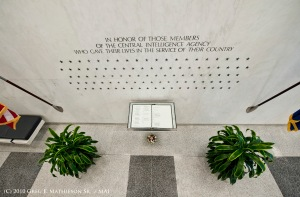 The CIA  Memorial Wall inside the entrance of the Central Intelligence Agency Headquarters which currently has 102  stars engraved for each member of the agency that gave of his/her life in the line of duty.  Names of those are listed in the book below, w
